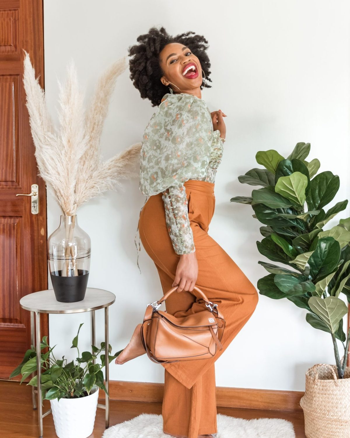 Ijeoma Kola posing and laughing - Inspirational Instagram accounts