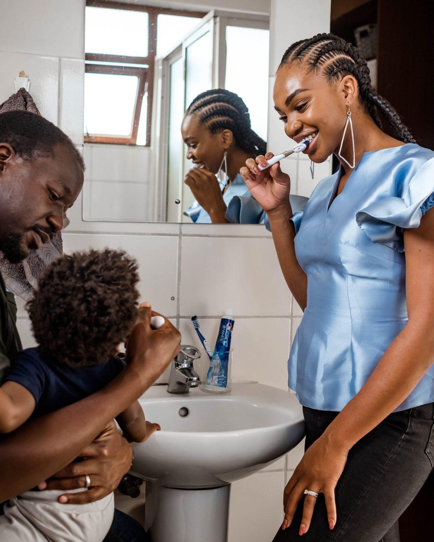 Ijeoma and Jonathan Kola and son brushing teeth with Crest toothpaste