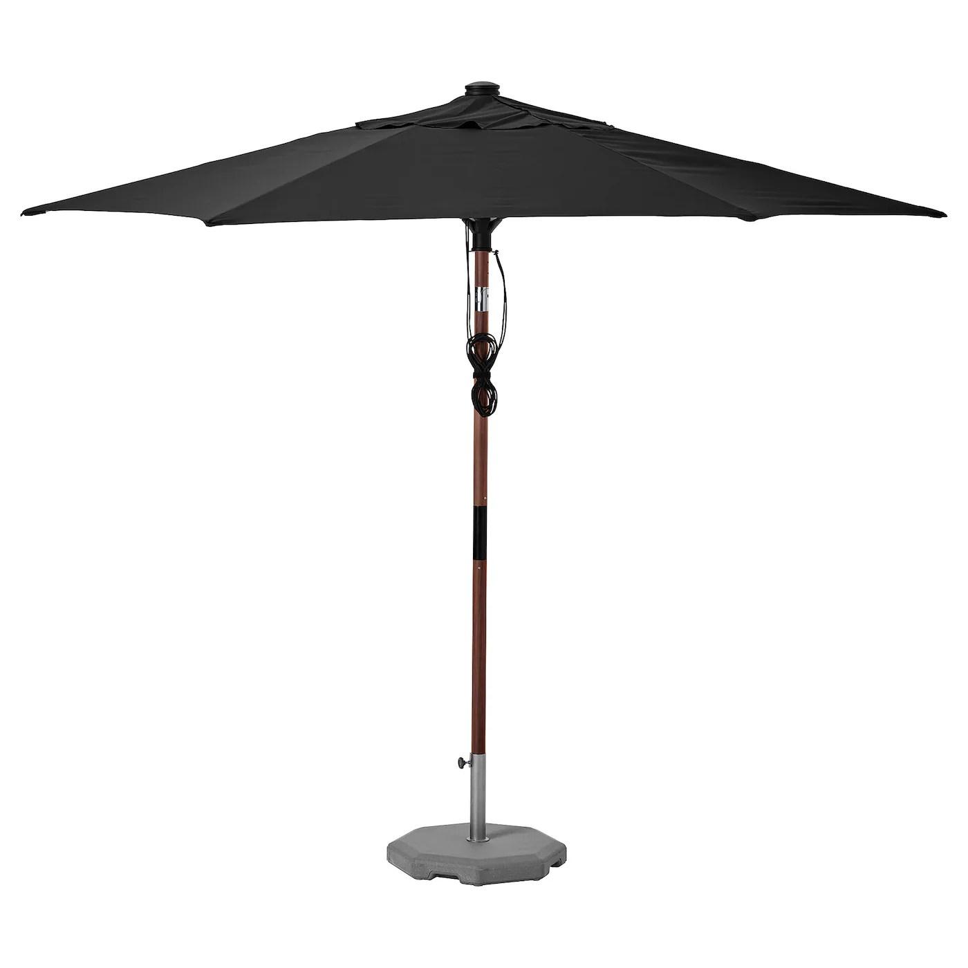 https www ikea com ca en p betsoe lindoeja patio umbrella with base brown wood effect black huvoen s49325535