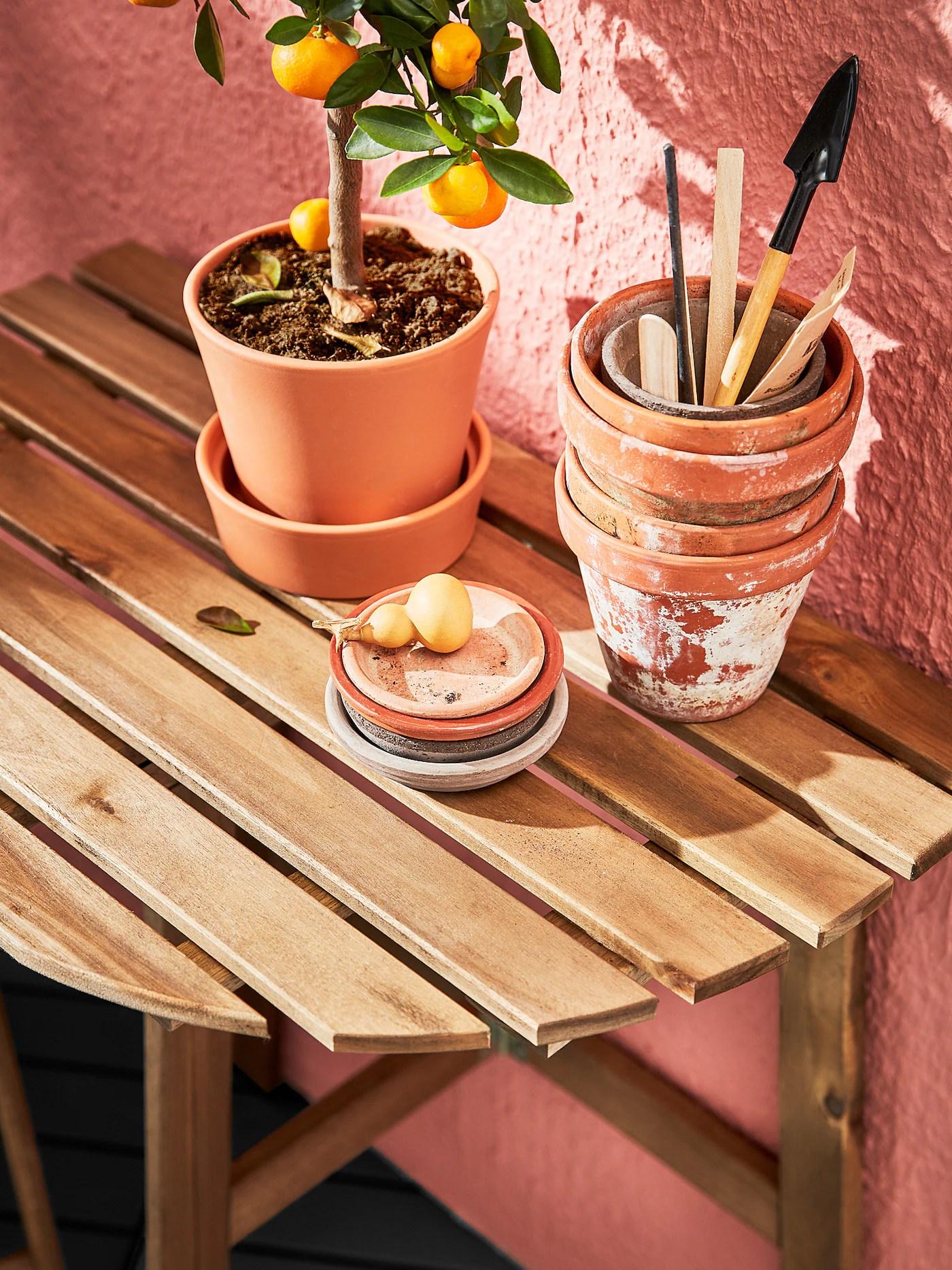 askholmen table murale ext pliant teinte brun clair 70x44 cm