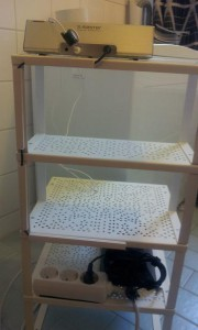 Variera shelf insert turned into a bathroom shelf for speaker electric shaver and other stuff