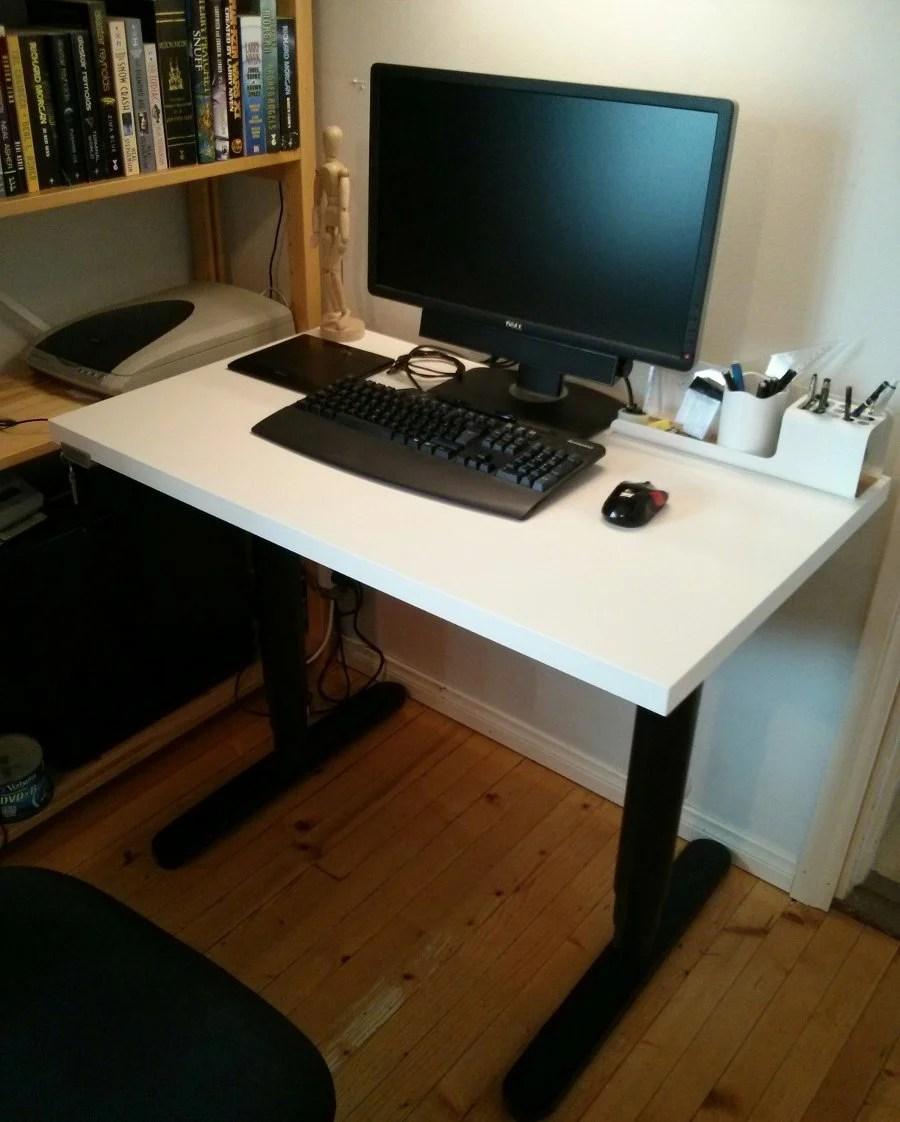 An adjustable width Bekant desk  IKEA Hackers