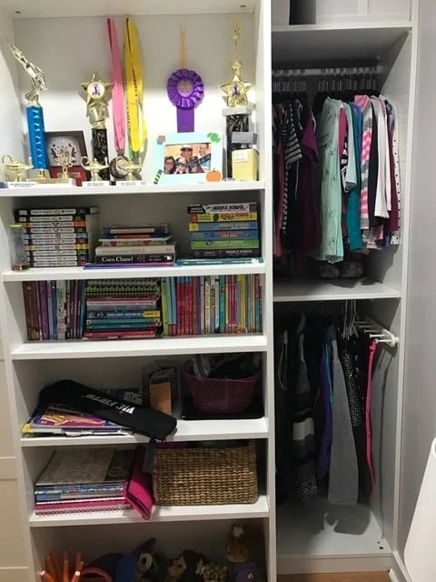 BILLY bookcase (in front) for toys and games and PAX wardrobe (behind) for clothes