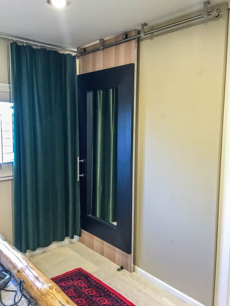 Mongstad Mirror Barn Door to separate ensuite from bedroom