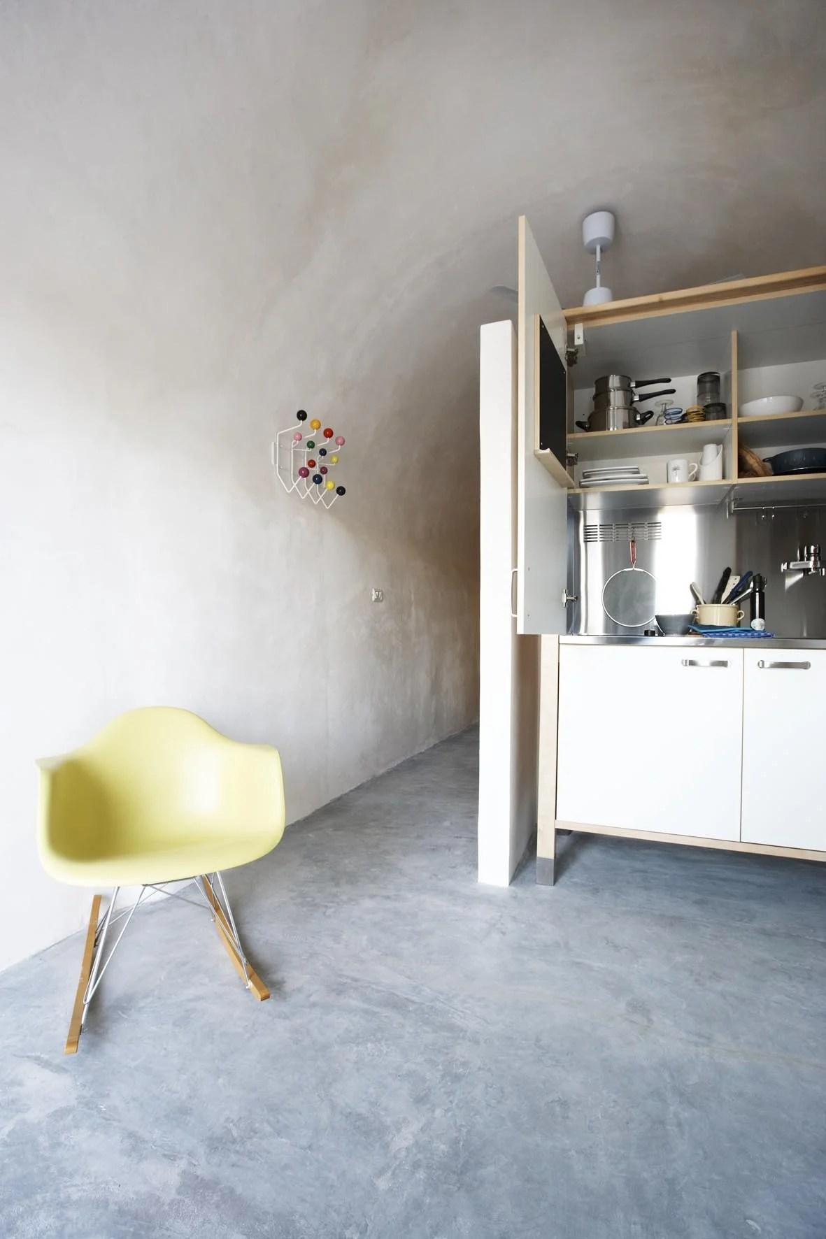 hidden kitchen behind swing door