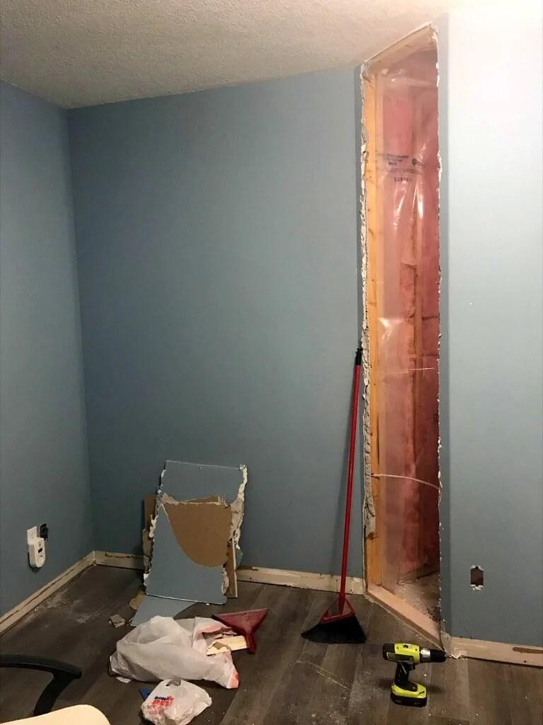 demolishing the dry wall