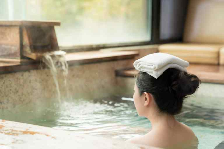 onsen singapore - Towel on lady's head while she is taking an onsen