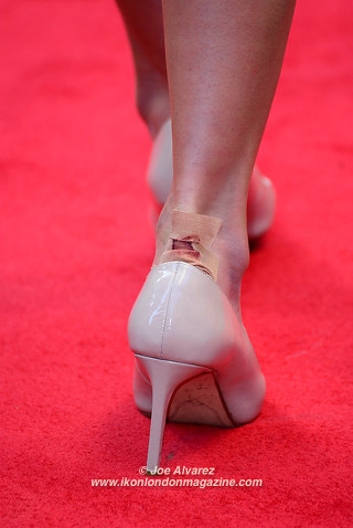 Laura Wright and her shoe malfunction at the Florence Foster Jenkins premiere © Joe Alvarez