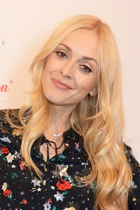 Fearne Cotton wearing Cath Kidston dress and Vivienne Westwood boots at the FearneXCathKidston launch party.© David Bennett