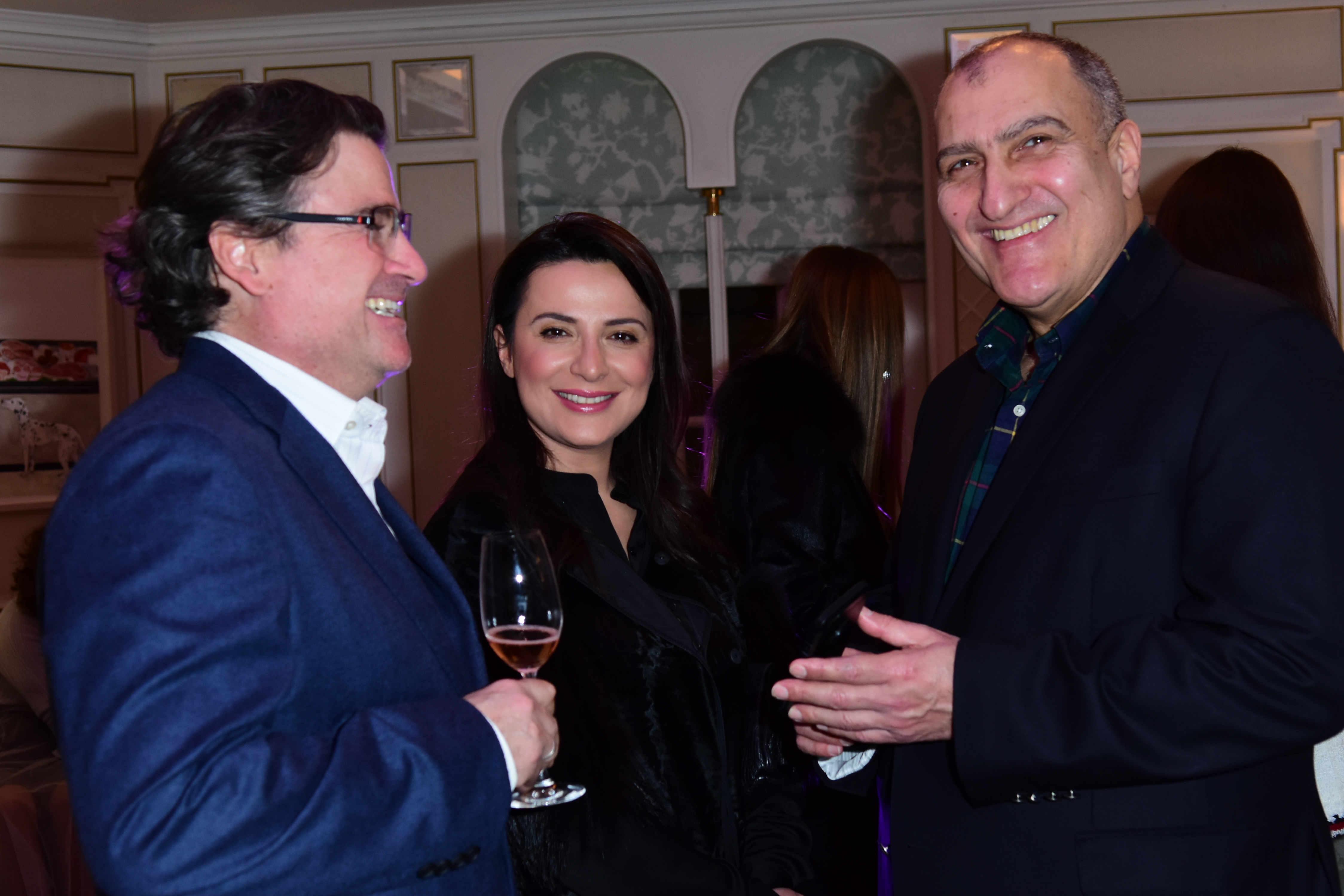 lex and Aygun Parviz and founder of Fortras Aga Rasulov Fortras fashion showcase at Fortnum and Mason. © Joe Alvarez