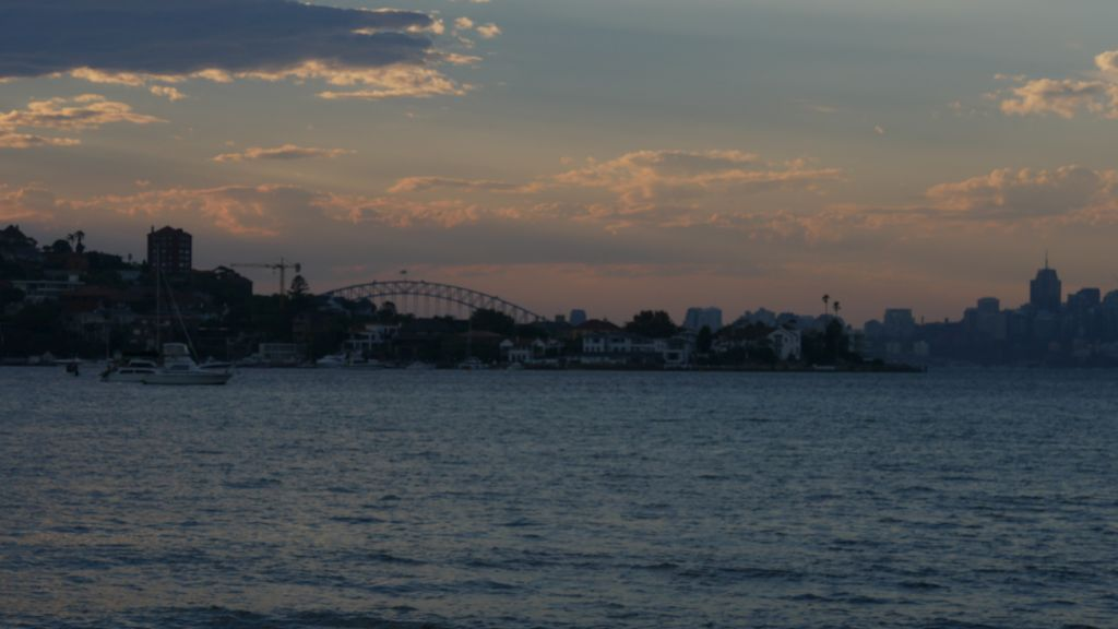 Sunset with Harbour Bridge in Sydney from Rose Bay Beay