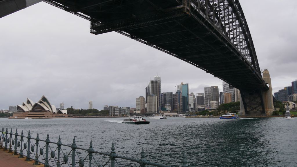 Picture taken from under the Harbour Bridge with skyline of Sydney and the Opera House