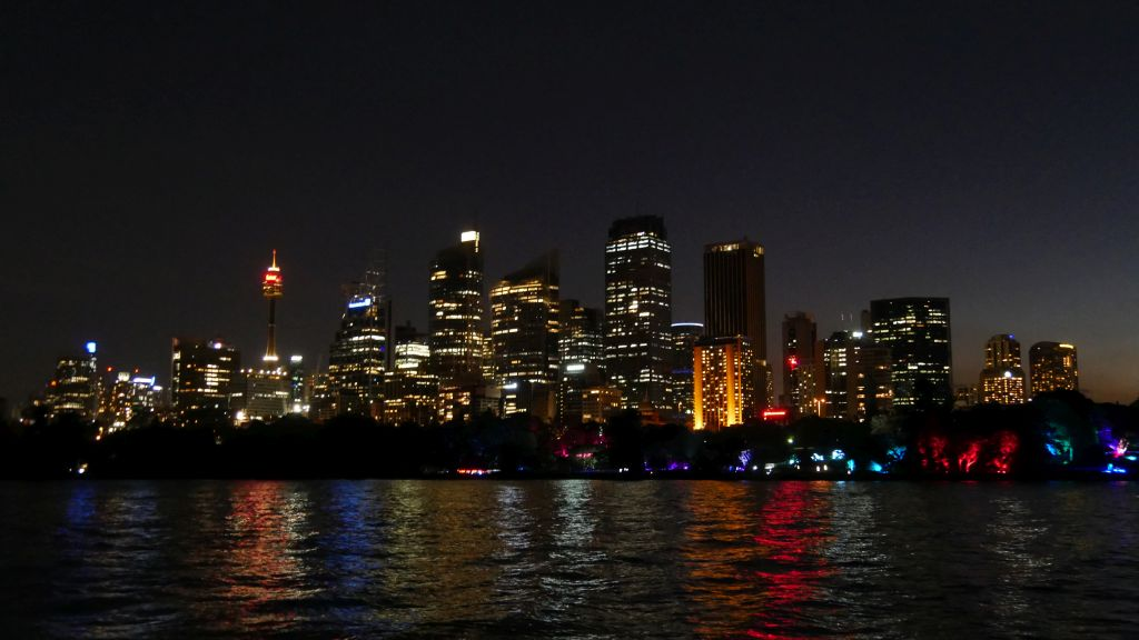 Skyline of Sydney in the dark with lights of Vivid