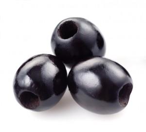 three black olives isolated on white