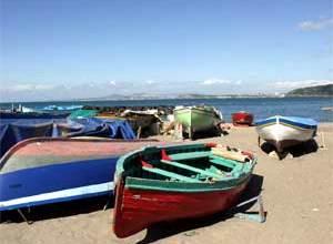 Photo of Mandra, via le barche dalla spiaggia