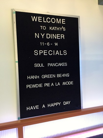 "The ""menu"" in the kitchen, which also doubles as a diner set"