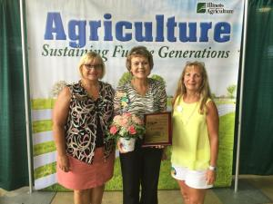 IAW President Susan Wall, Pat Yeagle, and VP Denise Smith at the Illinois State Fair when Pat Yeagle received the Outstanding Woman Famer Award. August, 2015