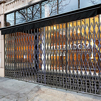 storefront folding security gates from iep are built custom to fit required application and desired aesthetic whether window or door top track