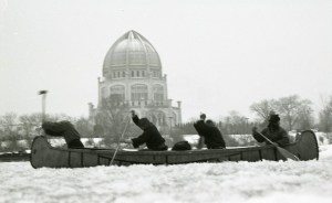Photo by Barton Dean Bow man hacks at solid ice as fellow crewmen paddle through the thick slush in front of Wilmette's Baha'i Temple in December 1976.