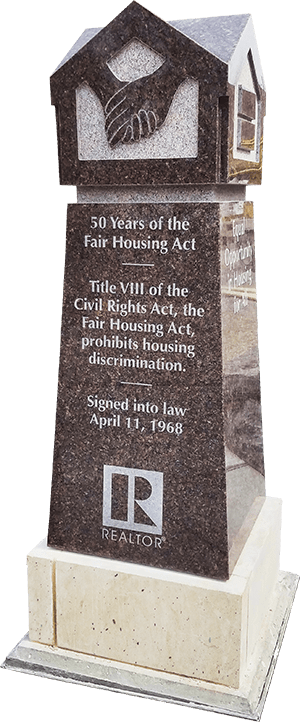 A monument commemorating the federal Fair Housing Act stands in Bicentennial Plaza — A REALTOR® Community Partnership, outside the association's Springfield headquarters.