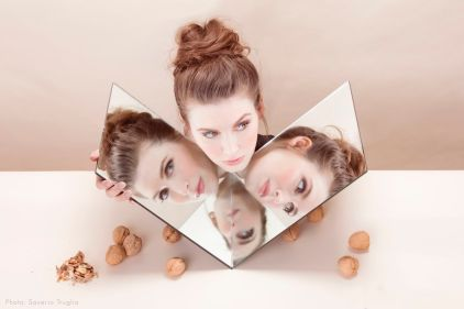 Jeanette Andrews with face reflected in mirrors
