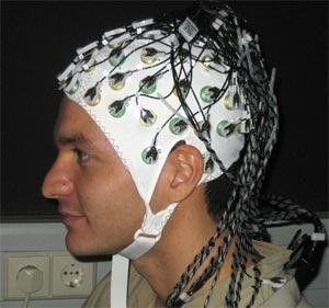 Someone wearing an EEG cap brain games