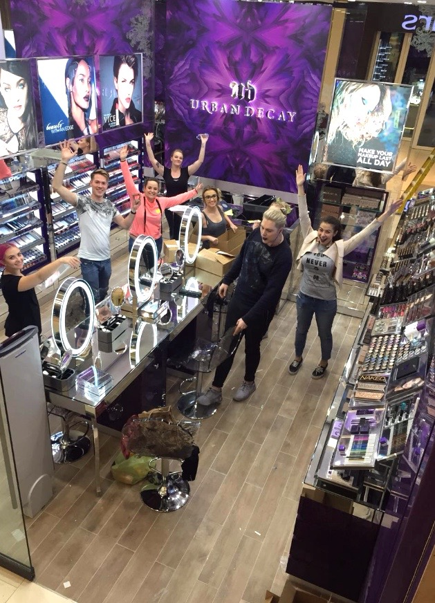 8 hours until opening- our team hard at work at merchandising the store!:)