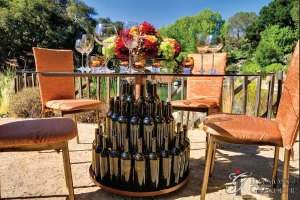 "Wine Bottle Tables 60"" Glass Tops x 30""h"