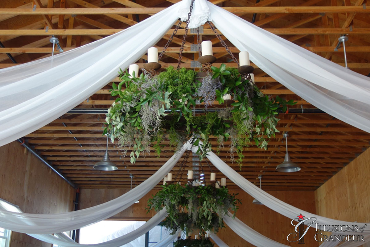 Wrought Iron Chandeliers and Drape in Barn