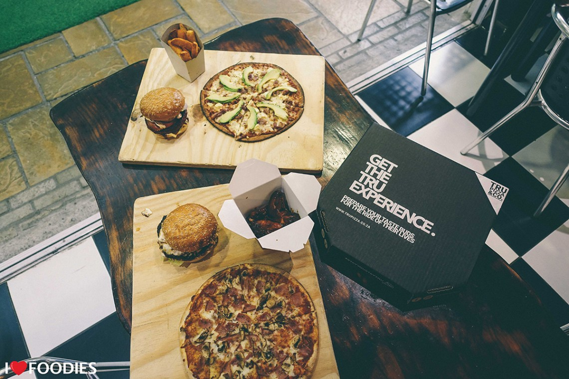 A Tru Pizza Feast - burgers, chicken wings, fries, pizzas