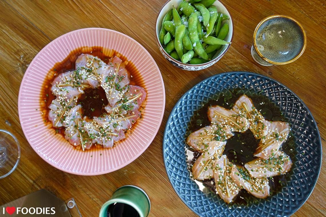 Salmon and tuna sashimi with salted edamame beans