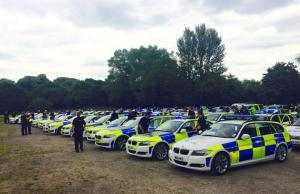 100 police vehicles and 200 officers are briefed prior to the operation