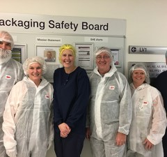 Patient Sue Vincent 2nd from left visits packing at AstraZeneca