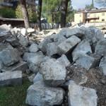 Le pietre recuperate della torre campanaria