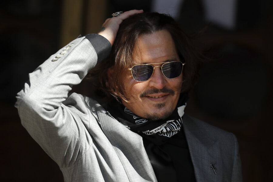 """FILE – In this file photo dated Tuesday, July 28, 2020, US Actor Johnny Depp arrives at the High Court in London during his case against News Group Newspapers over a story published about his former wife Amber Heard, which branded him a 'wife beater'.  A British judge is set to deliver his judgement in writing on Monday Nov. 2, 2020, deciding whether a tabloid newspaper defamed Depp by calling him a """"wife beater.""""  (AP Photo/Frank Augstein, FILE)"""