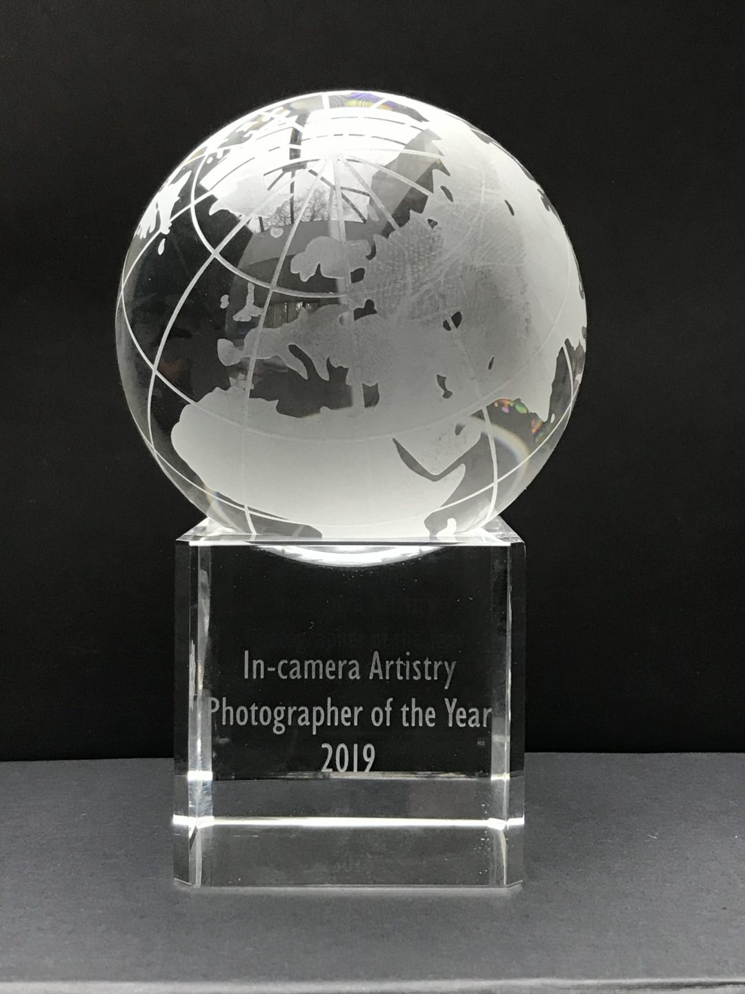 In Camera Artistry award from the SWPP rotating engraved globe on glass stand