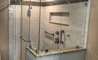 Frameless barn style sliding shower door installed in ...