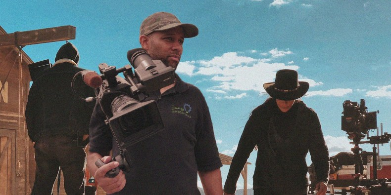 Julian Springer on western set with video camera.