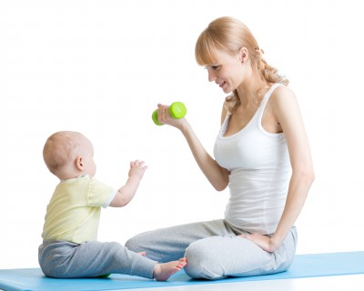 Mother and little kid spending time in gymnastics isolated