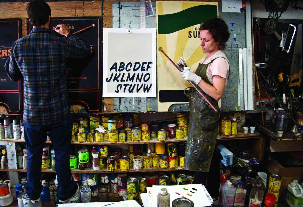(Ken Davis and Caitlyn Galloway of New Bohemia Signs. Courtesy of Sign Painters and Princeton Architectural Press.)