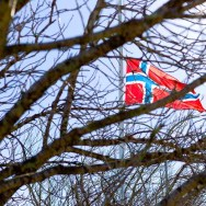 a Norwegian flag at half-mast