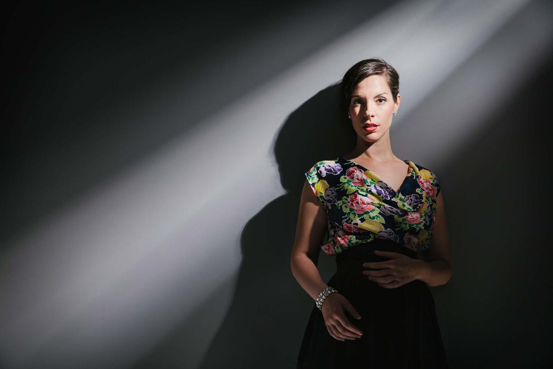 Studio portrait and promotional photography of jazz singer Georgia Brooks with an interesting beam of light created by Melbourne professional photographer Sharon Blance.