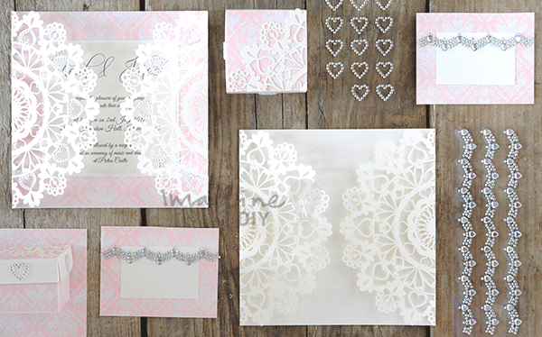 Laser Cut Invitation DIY wedding stationery ideas. Pink and white laser cut wedding stationery with heart details. Crystal embellishments. Ideas to make your own wedding invitations