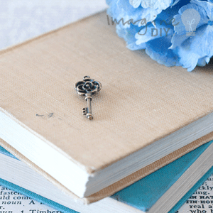 rose key bronze. Small decorative key with flower details. DIY wedding stationery, card making and paper craft supplues