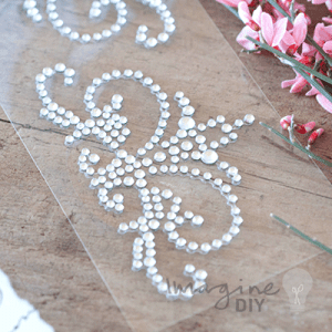 Large crystal embellishment for decorating wedding invitations and stationery.