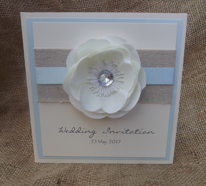 pretty blue and ivory wedding invitation with flowers. Made by Anna Carter of Cardiff Invitations