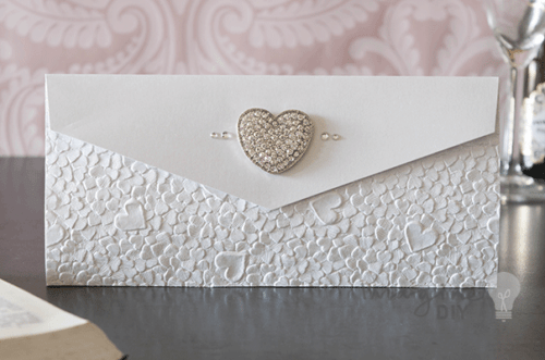 Heart Embossed Pocket Invitation Pocket Hearts Invitation wedding idea for embossed heart invitation in silver and white. Pocket fold invitation to make yoursed