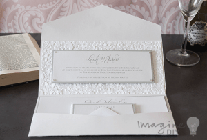 Silver and white envelopment invitation with pocket. Embossed with hearts. romantic wedding invitation to make yourself