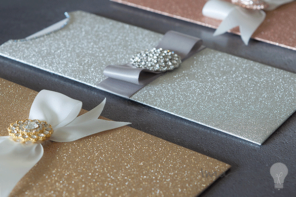 blank glitter wedding invitations. DIY wedding stationery. Blank invitation pockets covered in glitter