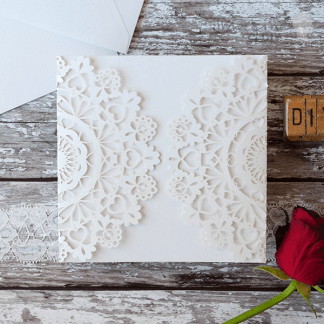 enchanted white laser cut invitation. Blank white laser cut invitation with heart details. DIY wedding stationery supplies